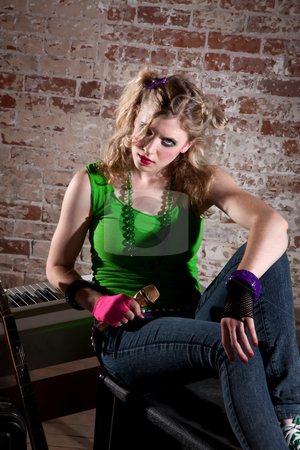 Young Punk Rocker stock photo, Young punk rocker girl with blond hair practices singing by Scott Griessel
