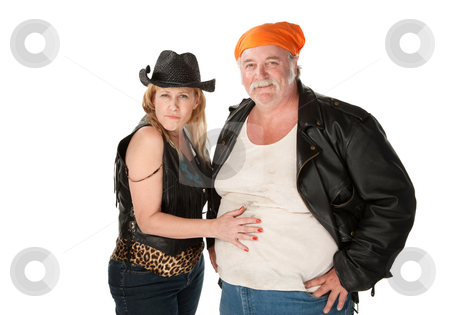 Woman touching a big belly on her male friend or husband stock photo, Woman in leopard skin cowgirl outfit flirting with big bellied man by Scott Griessel
