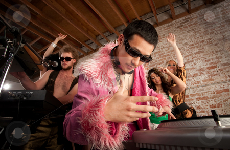 1970s Disco Music Party stock photo, Cool Asian DJ at a 1970s Disco Music Party by Scott Griessel