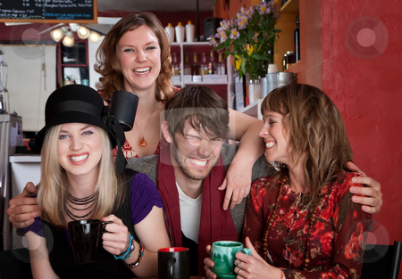 Mr. Charisma stock photo, Charismatic young hipster with three female friends at a cafe by Scott Griessel