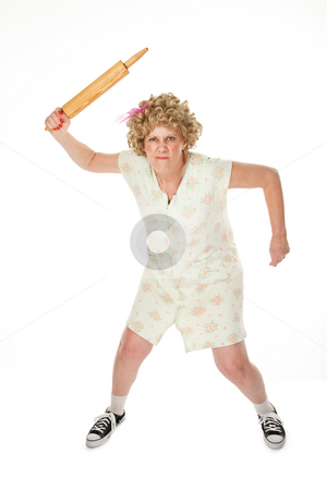 Rolling Pin Punishment stock photo, Angry housewife with rolling pin on white background by Scott Griessel