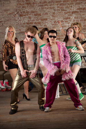 Raunchy Dancers stock photo, Raunchy dancing men with sunglasses at a 1970s Disco Music Party by Scott Griessel