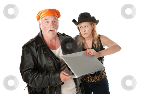 Busybody stock photo, Embarrassed woman with a spouse viewing her laptop screen by Scott Griessel