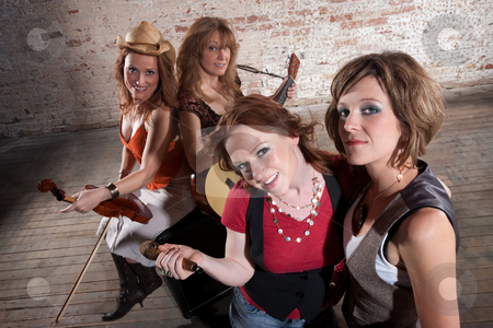 Female musicians stock photo, All-Female band members gathering before a performance by Scott Griessel