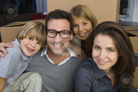 Family stock photo, Portrait of a Family lying in front of Cardboard Boxes by Alexander Beck