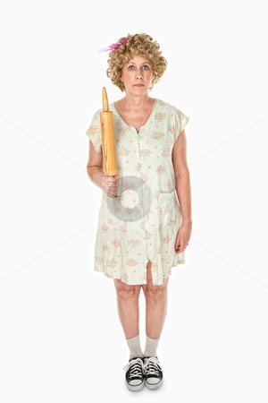 Rolling Pin Pose stock photo, Unmoving housewife with rolling pin on white background by Scott Griessel