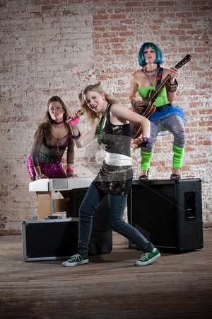 Female punk rock band stock photo, Young all girl punk rock band performs in front of brick wall by Scott Griessel
