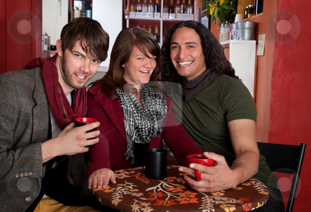 Three friends in a Coffee House stock photo, Two handsome men seeking a young lady's attention by Scott Griessel