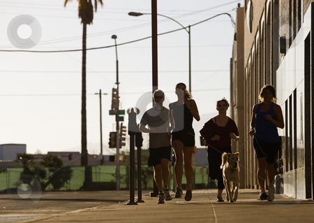 Group of friends out for a run stock photo, Man and women running in the city by Scott Griessel