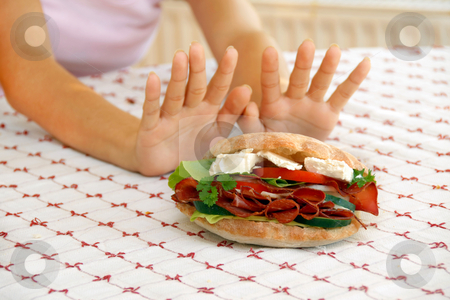 Diet stock photo, Female hands refusing big meat sandwich with ham and cheese by Julija Sapic