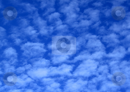 Blue sky with clouds stock photo, Blue sky at day time with soft white clouds by Henrik Lehnerer