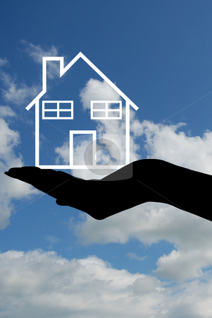 House silhouette stock photo, Hand silhouette holding a house with sky in background by Ioana Martalogu
