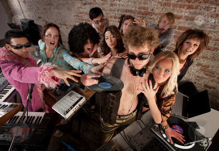 1970s Disco Music Party stock photo, Famous DJ crowded by fans and requests at a party by Scott Griessel