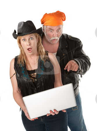 Very Surprised stock photo, Biker couple surprised about something on a laptop by Scott Griessel