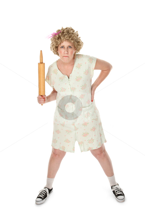 Mean Mama stock photo, Annoyed housewife with rolling pan on white background by Scott Griessel
