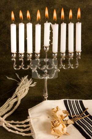 Prayer shawl and hanukkah stock photo, Hanukkah candle-holder and a jewish prayer shawl by Anneke