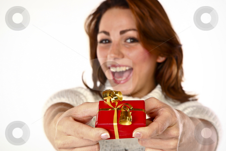 Gift Offer Joy stock photo, Conceptual Photo Of A Cheerful Cute Woman Offering A Gift by Nick Fingerhut