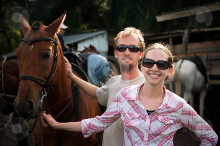 Equestrian Couple stock photo, Equestrian couple posing on a horse ranch in Costa Rica by Scott Griessel