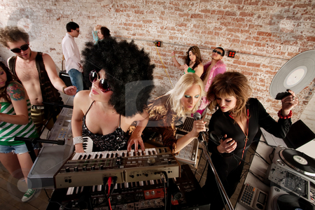 1970s Disco Music Party stock photo, Three female performers at a 1970s Disco Music Party by Scott Griessel