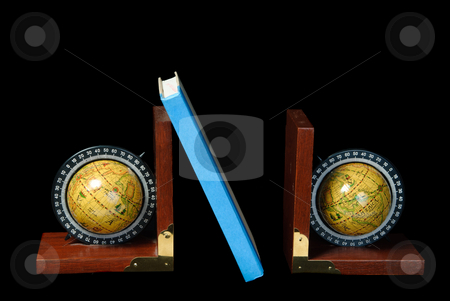 World Bookends stock photo, Two world globe bookends holding up a book, isolated against a black background by Richard Nelson