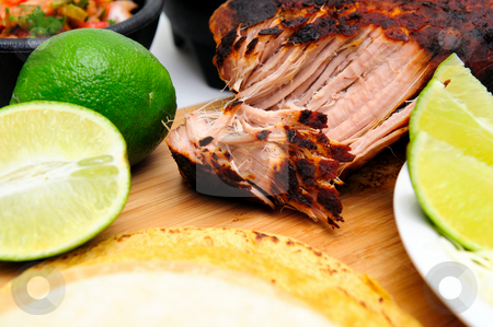 Cooked Pork Carnitas stock photo, Pork Carnitas pulled apart ready to make tacos with fresh sliced lime by Lynn Bendickson