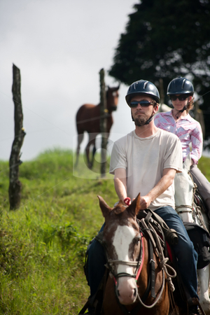 Equestrian Couple stock photo, Equestrian couple on horses ranch in Costa Rica by Scott Griessel