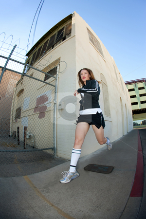 Pretty, stylish jogger run in the city stock photo, Woman runs downtown in tube socks. by Scott Griessel