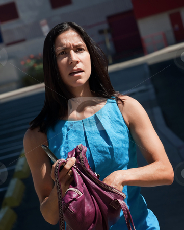 Confused, pretty women struggles to understand. stock photo, Woman, standing looking confused on city street. by Scott Griessel
