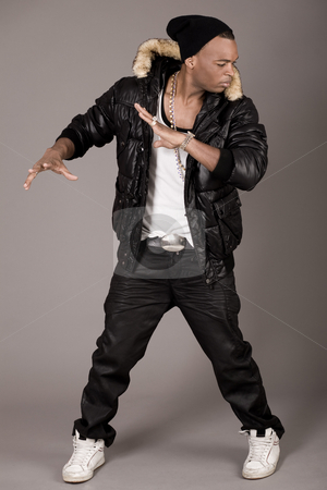 Cool young african american man dancing stock photo, Cool young african american man dancing on grey background by Get4net