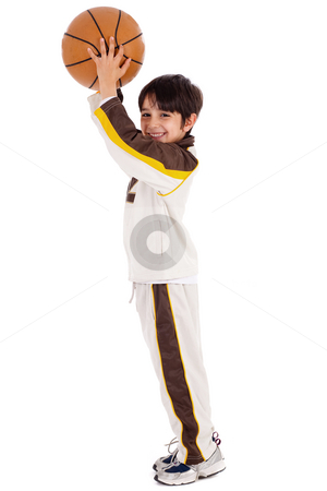 Young caucasian boy while playing basket ball stock photo, Young caucasian boy while playing basket ball over white background by Get4net