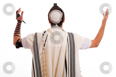 Men praying stock photo, Jewish men put phylactery on isolated background by Get4net