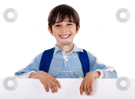 Smiling young boy behind the blank board stock photo, Smiling young boy behind the blank board on isolated white background by Get4net