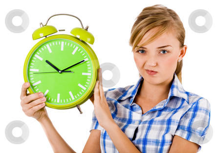 Girl giving funny expression and holding the alarm stock photo, Girl giving funny expression and holding the alarm on a isolated white background by Get4net