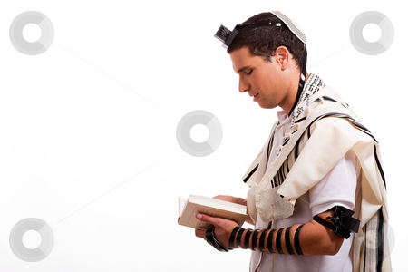 Side view of young  jewish man with book stock photo, Side view of young  jewish man with book on white isolated background by Get4net