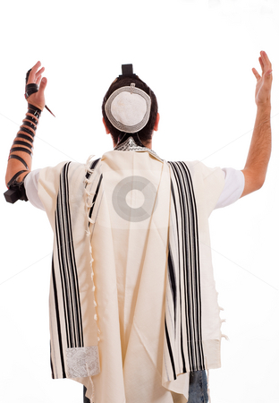 Rear view of jewish men put phylactery stock photo, Rear view of jewish men put phylactery on isolated background by Get4net