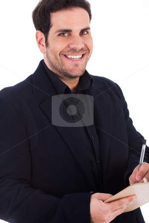 Young man writting on a pad with pen  stock photo, Young man writting on a pad with pen on a white background by Get4net