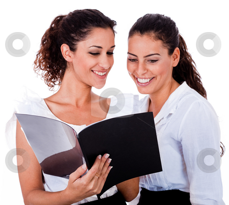Young business colleagues looking at the files stock photo, Young business colleagues looking the file on isolated white background by Get4net