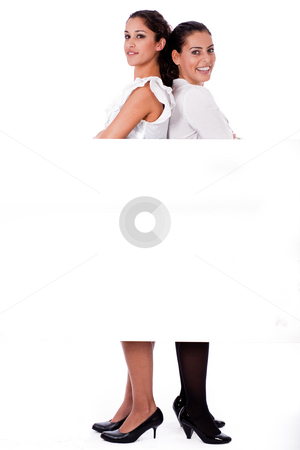 Woman stabding back to back stock photo, Woman stabding back to back on isolated white background by Get4net