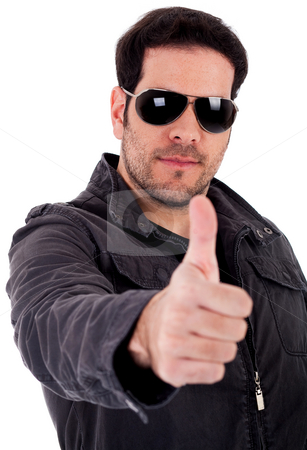 Fashion model showing thumbsup wearing sunglasses stock photo, Fashion model showing thumbsup wearing sunglasses on a white background by Get4net