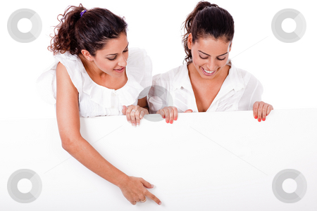 Business woman pointing a blank board to her colleague stock photo, Business woman pointing a blank board to her colleague on isolated white background by Get4net