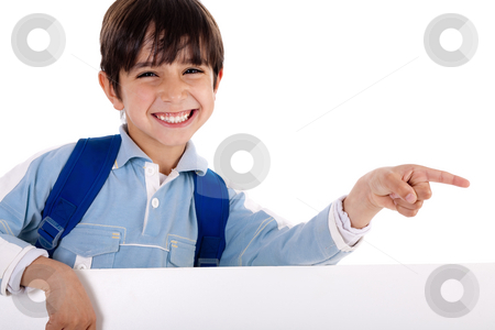 Happy young boy pointing to copy sapce stock photo, Happy young boy pointing to copy sapce on isolated white background by Get4net