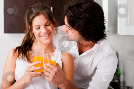 Youn couple cheersing stock photo, Youn couple cheersing their drink by Get4net