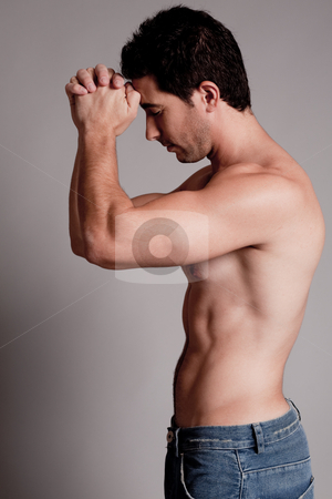 Shirtless man hold his hands on the head stock photo, Shirtless man hold his hands on the head on a grey isolated background by Get4net
