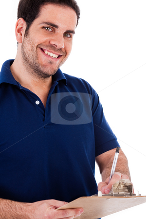 Casual man writting on a pad stock photo, Casual man writting on a pad on a white background by Get4net