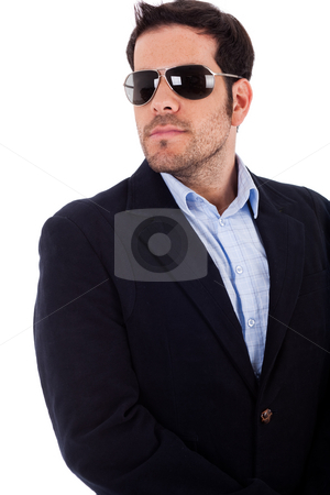 Young business man wearing sunglasses stock photo, Young business man looking right wearing his sunglasses on a white background by Get4net