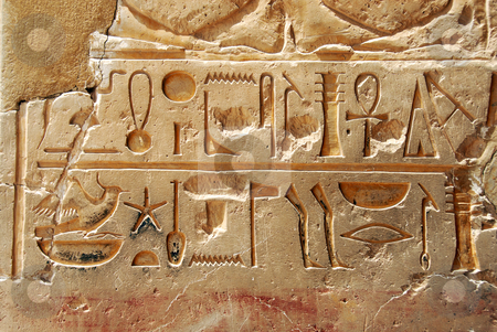 Egyptian  hieroglyphics stock photo, Egyptian  hieroglyphics on limestone wall in egyptian temple by Julija Sapic