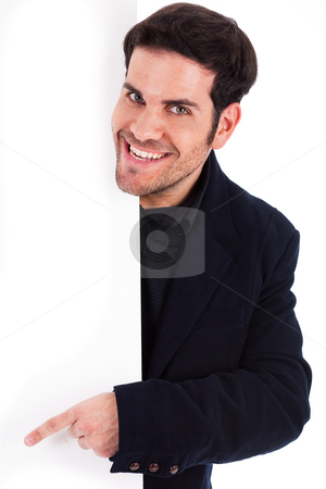 Portrait of a business man pointing at the blank board stock photo, Portrait of a business man pointing at the blank board wtih copy space by Get4net