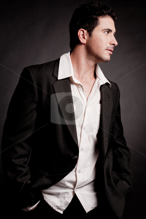 Attractive young man  stock photo, Attractive young man side view,indoor studio by Get4net