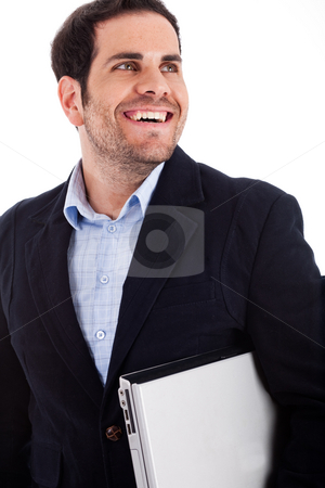 Young worker carrying a laptop  stock photo, Young worker carrying a laptop with a broad smile on a white background by Get4net