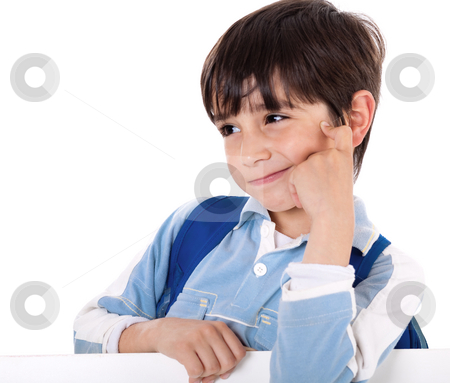 Portrait of a adorable school boy thinking stock photo, Portrait of a adorable school boy thinking on white isolated background by Get4net